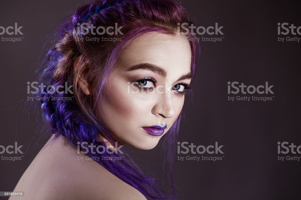 Close-up of a girl with blue hair stock photo