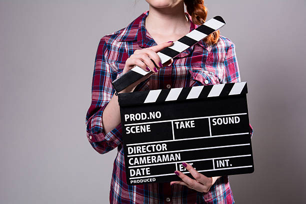 Close-up of a girl with movie clapper stock photo