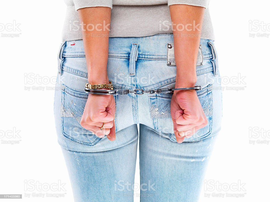 Closeup of a girl's hands in handcuffs stock photo