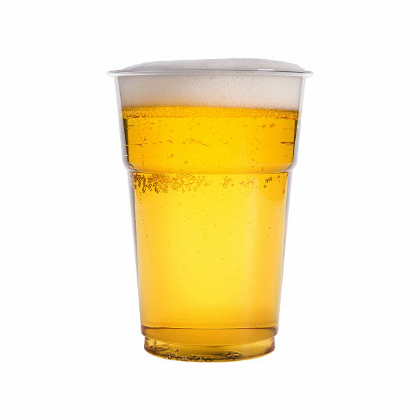 Close-up of a glass of beer on a white background glass of beer isolated on white background disposable cup stock pictures, royalty-free photos & images