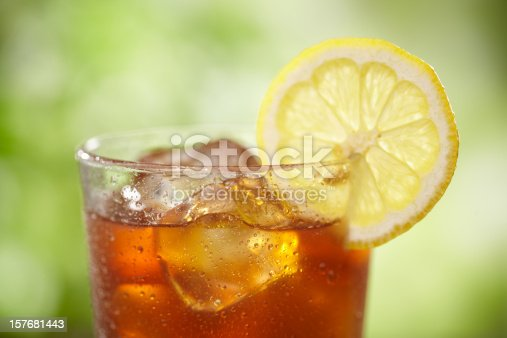 Tight shot of top of Iced tea in outdoor setting.
