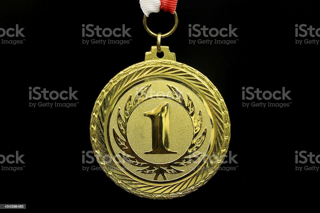 Close-up of a gold medal on a black background royalty-free stock photo