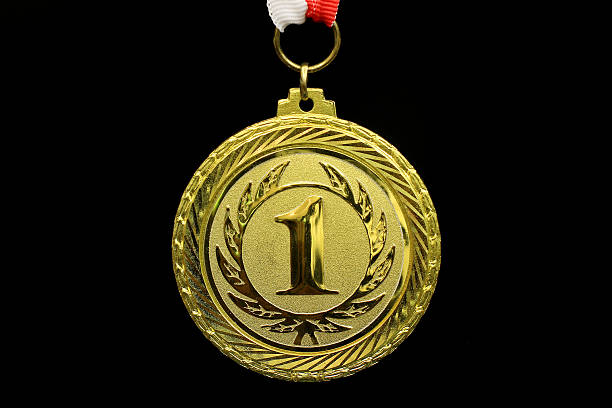 Close-up of a gold medal on a black background stock photo