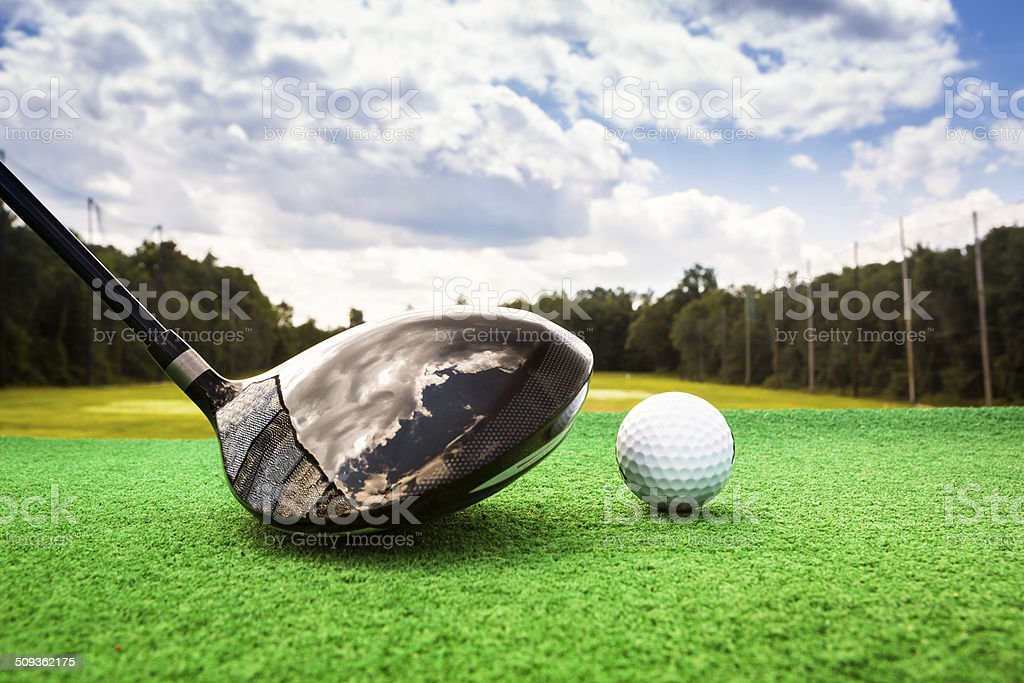 Close-up of a golf ball and a golf wood stock photo