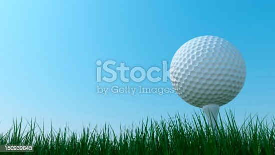 istock Close-up of a golf ball on grass in front of blue sky 150939643