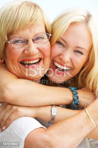 144362548istockphoto Close-up of a grandmother and granddaughter having fun 147273547
