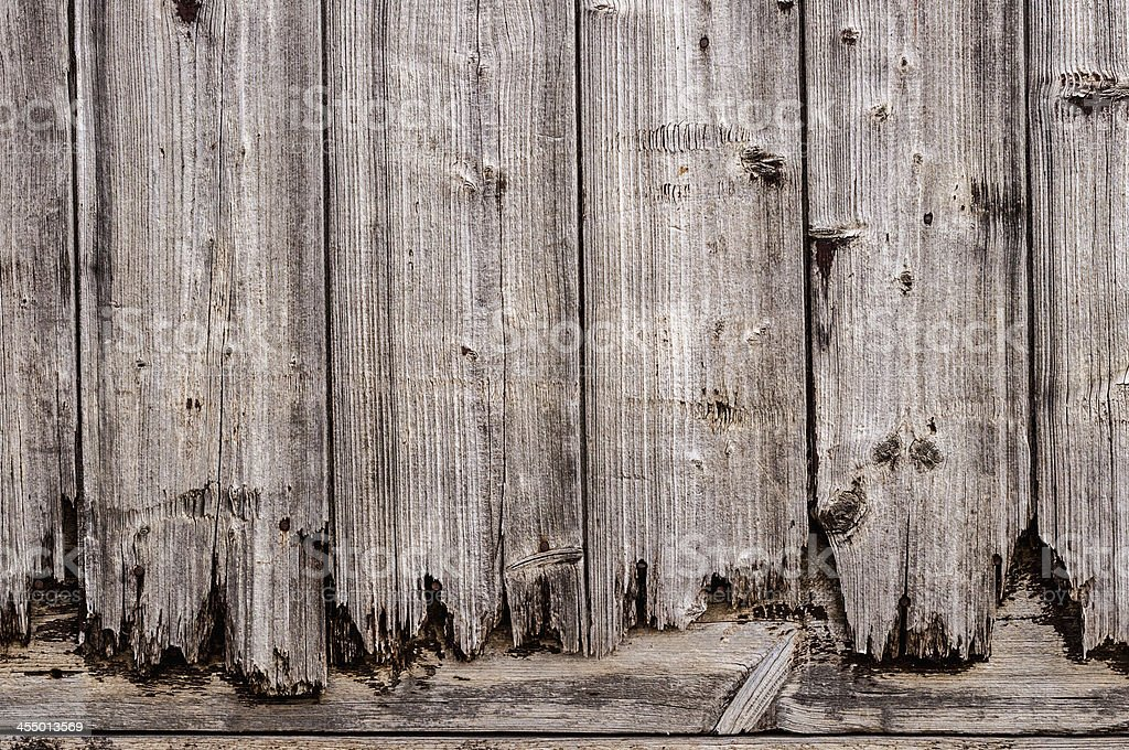 Close-up of a gray weathered wooden gate. wallpaper stock photo
