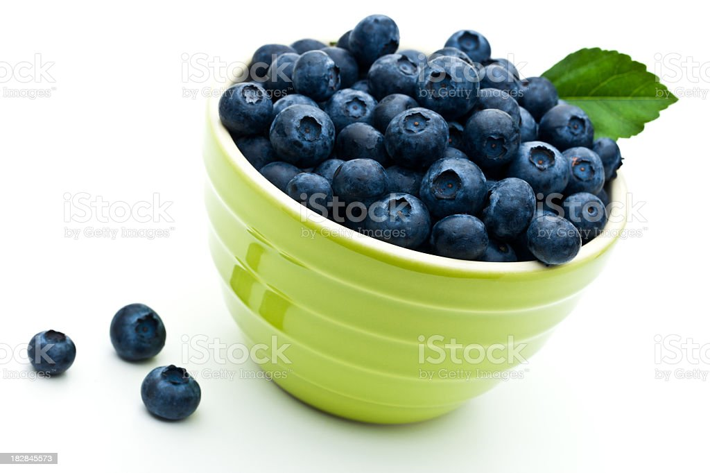 Close-up of a green bowl filled with blueberries royalty-free stock photo