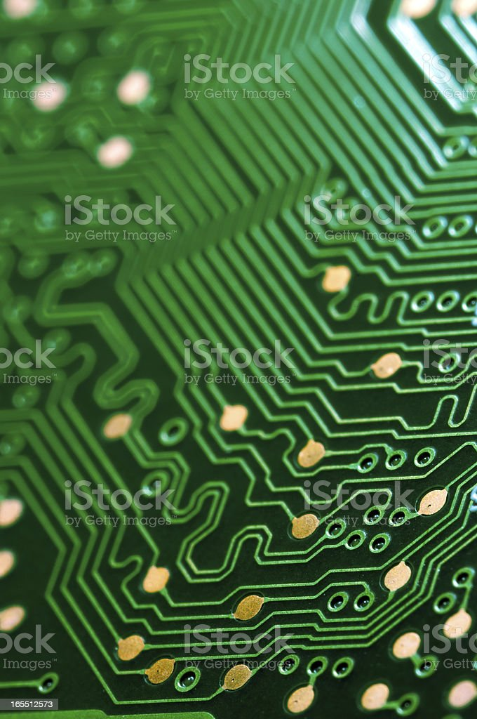 A close-up of a green electronic circuit board stock photo