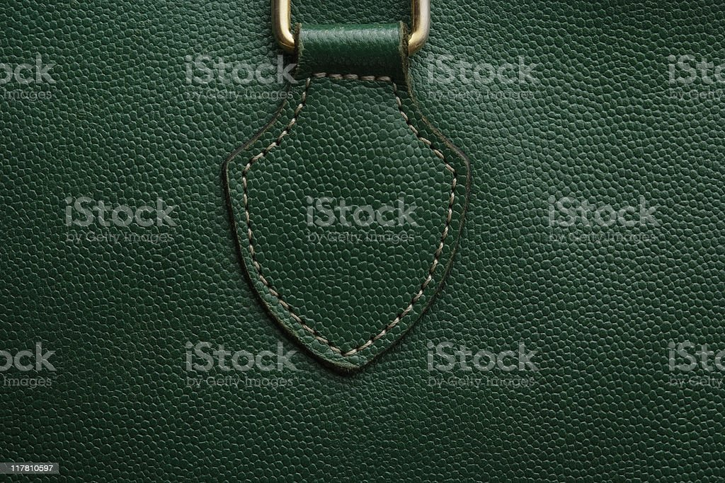 Close-up of a green leather bag texture background stock photo