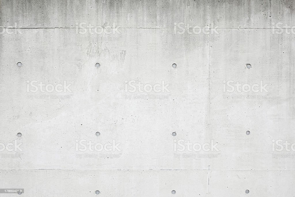 A closeup of a grey concrete wall stock photo