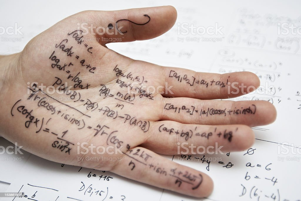 Close-up of a hand covered in formulas for a math class exam royalty-free stock photo