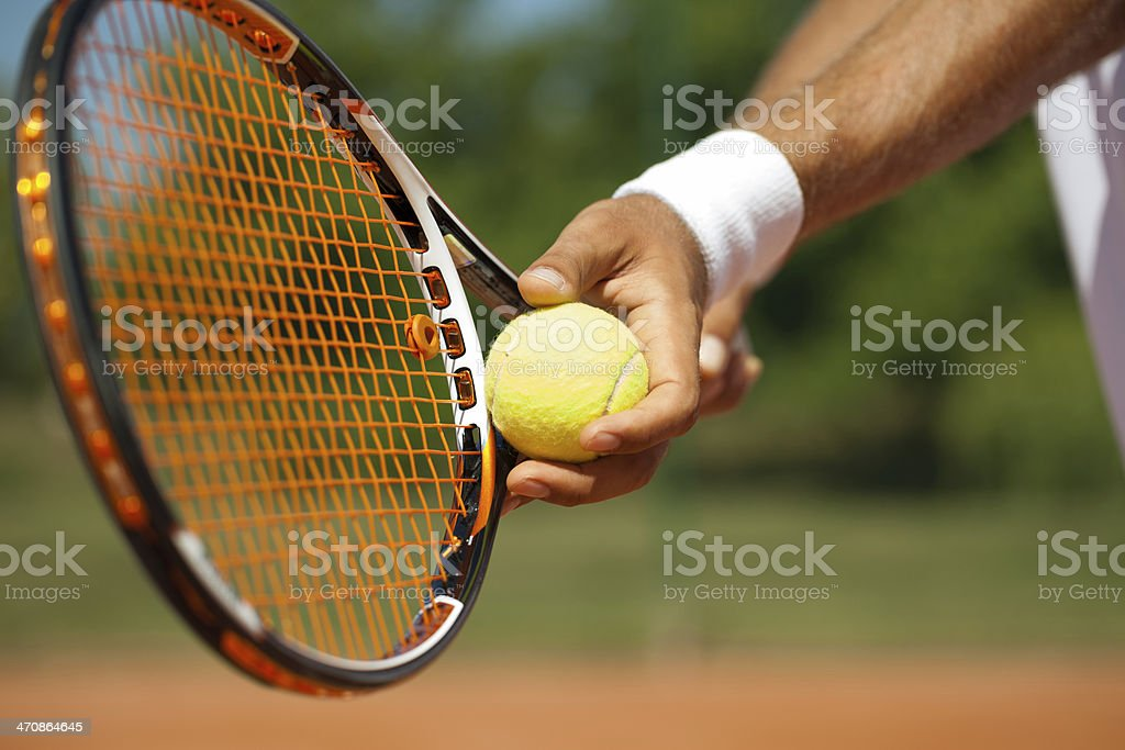 Close-up of a hand getting ready to serve at tennis stock photo