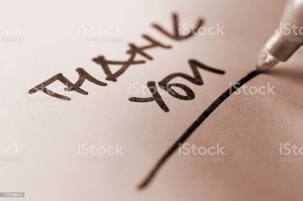 Closeup of a hand written Thankyou note with pen underlining royalty-free stock photo