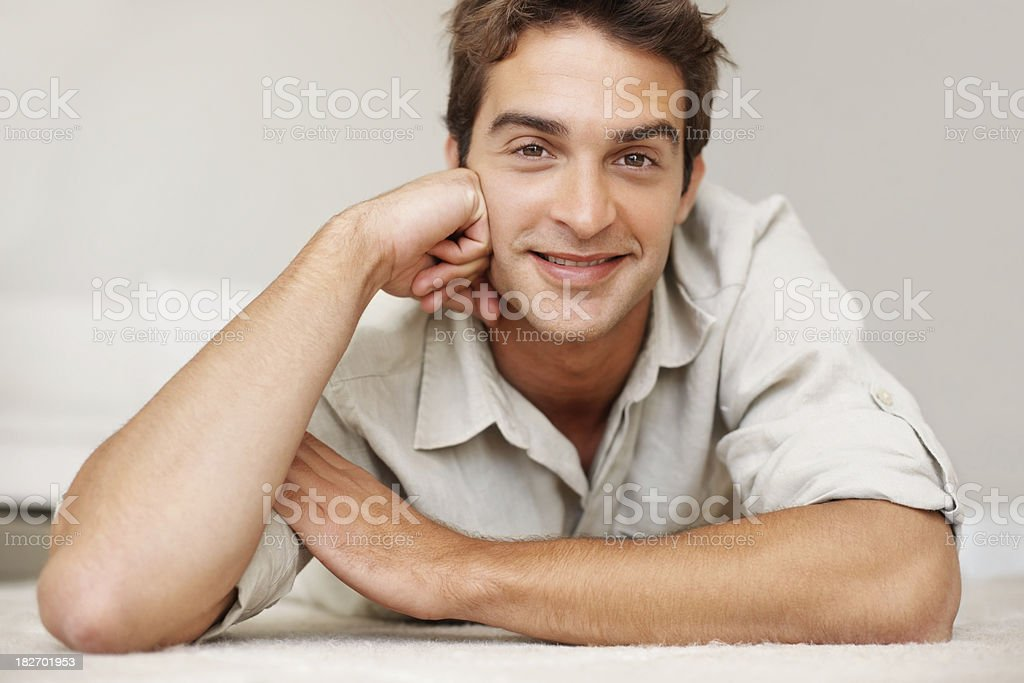 Closeup of a handsome young man smiling at home royalty-free stock photo