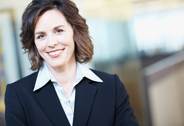 close-up of a happy mature businesswoman in office - medium length hair stock photos and pictures