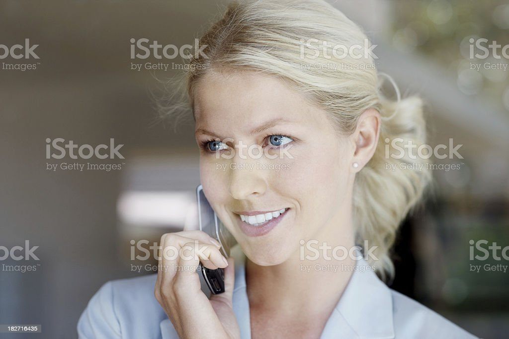Close-up of a happy young woman talking on mobile phone royalty-free stock photo