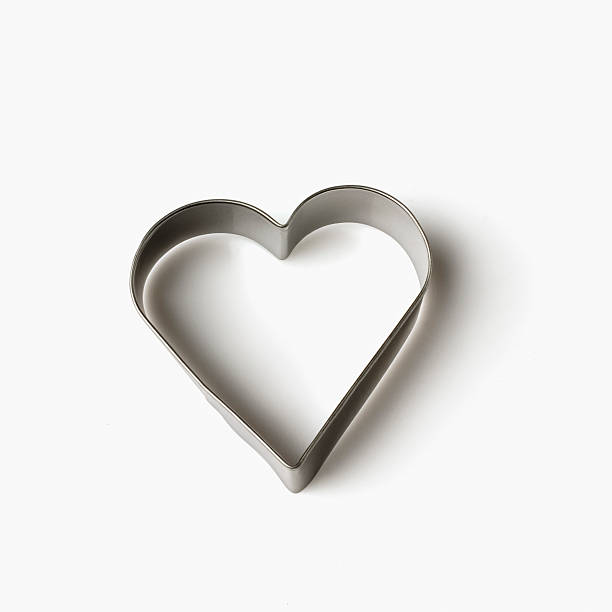 Close-up of a heart shaped pastry cutter Close-up of a heart shaped pastry cutter cookie cutter stock pictures, royalty-free photos & images