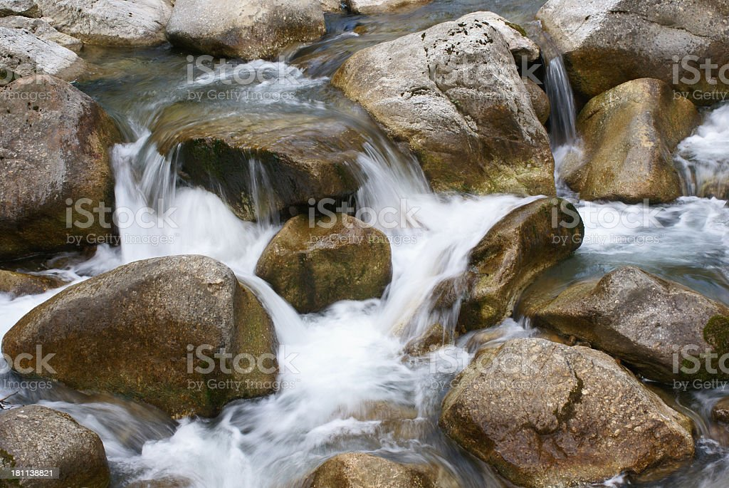 Close-up of a high mountain rocky water stream stock photo