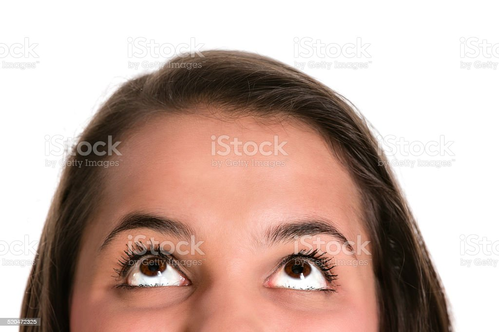 Close-up of a Hispanic young woman thinking of the options. stock photo