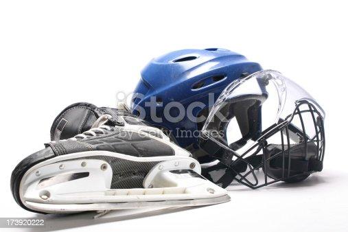 Close-up of a hockey helmet and skate
