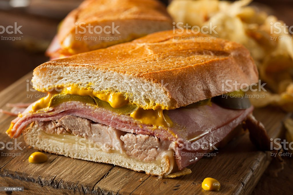 Close-up of a homemade Cuban sandwich on a wooden board stock photo