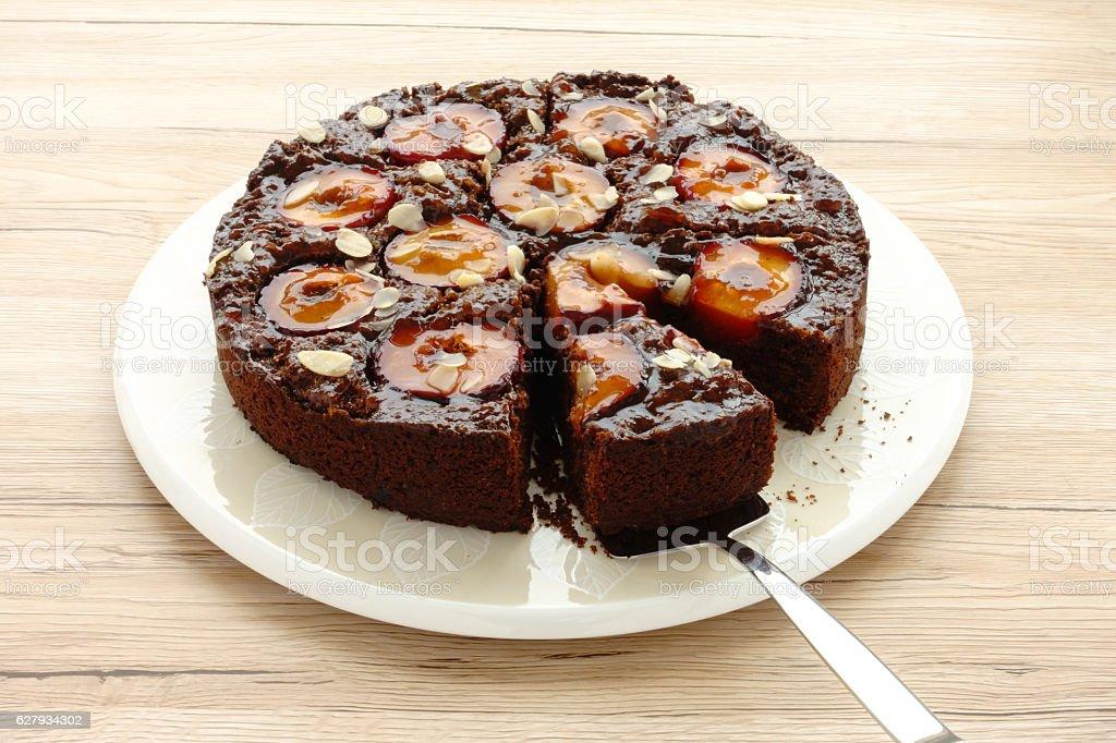 Closeup of a Homemade Sticky Chocolate Plum Cake stock photo