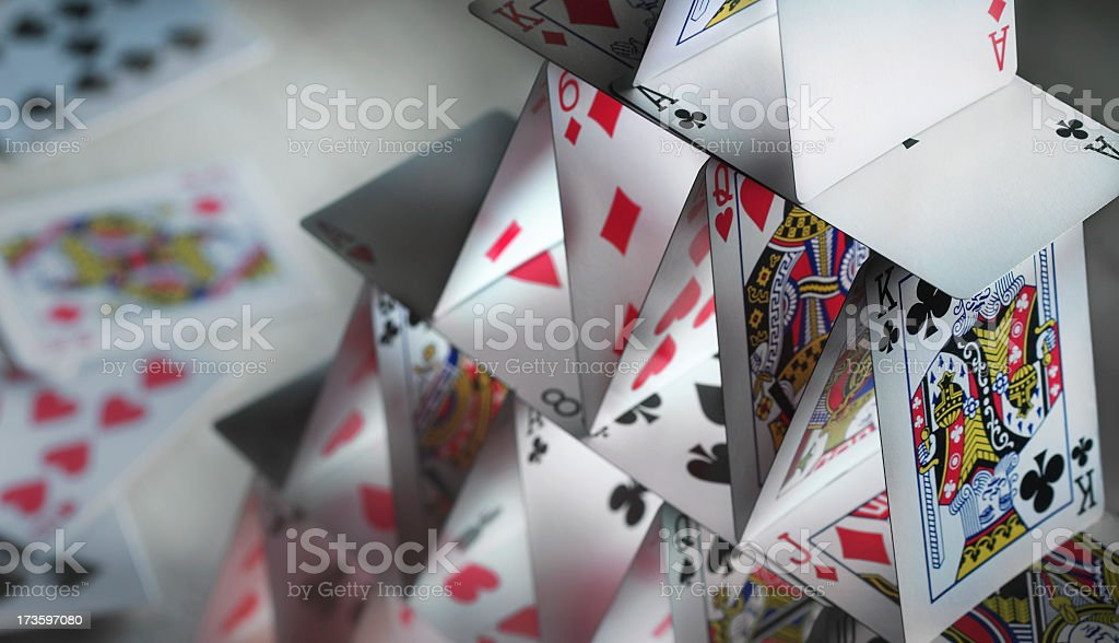 Close-up of a house of cards with spare cards in the back stock photo