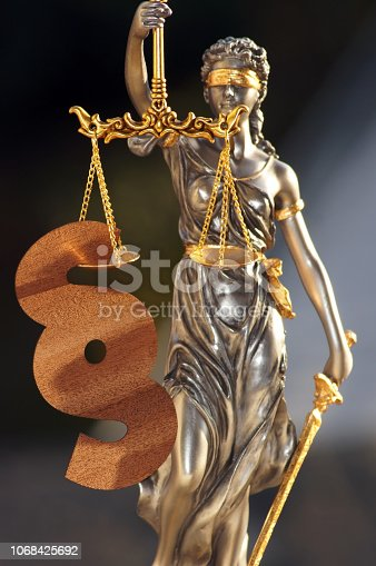 istock Close-up of a justice figure shines from sunlight 1068425692