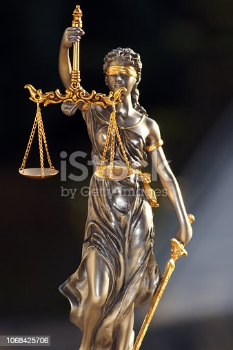 istock Close-up of a justice figure shines from sunlight 1068425706