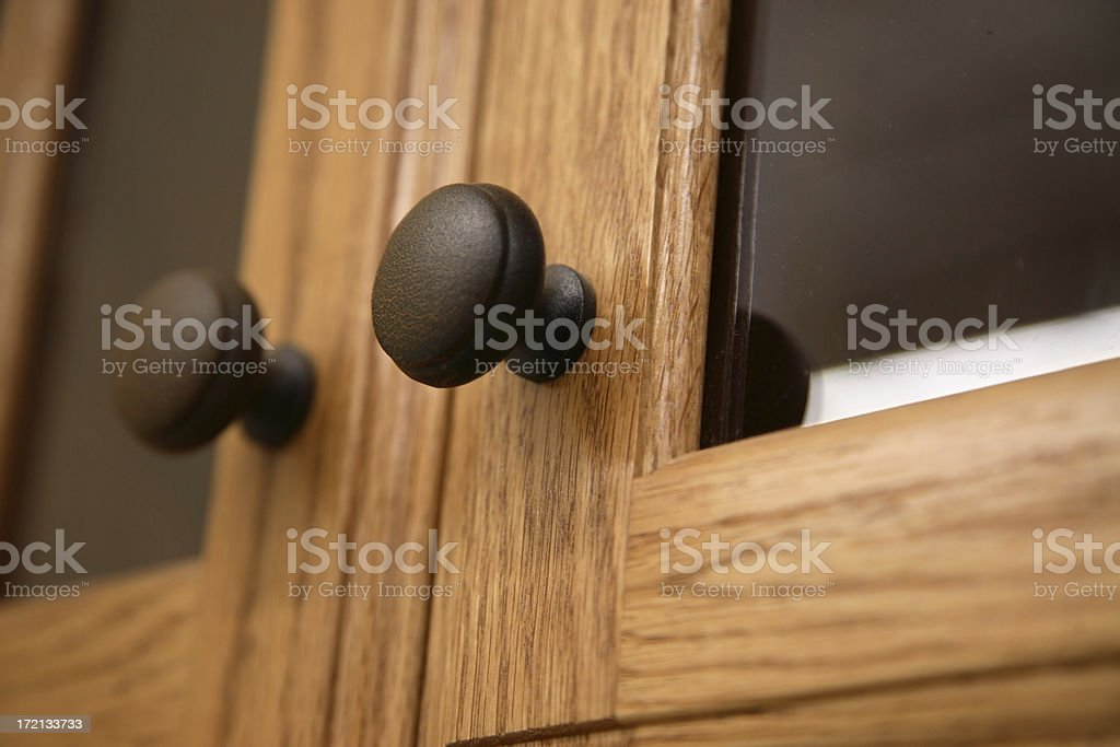 Close-up of a kitchen cabinet door knob in wood stock photo