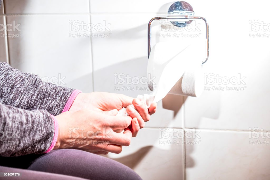 Close-up Of A lady's Hand Using Toilet Paper - Royalty-free Close-up Stock Photo
