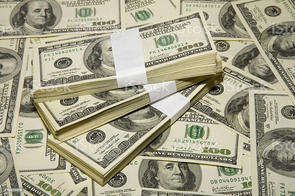 Closeup of a large pile of bundles containing US $100 bills stock photo
