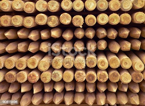 Pile of wooden fence poles. See more pictures of wood::