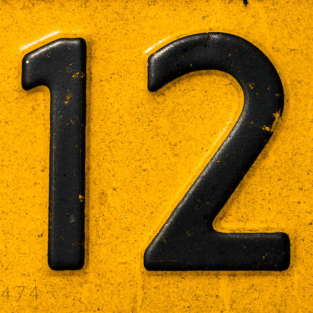 Closeup of a license plate with the number twelve stock photo