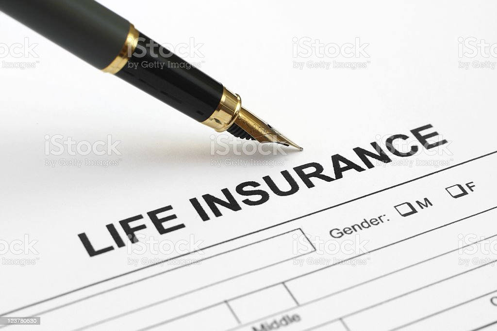 Close-up of a life insurance application with a pen on top royalty-free stock photo