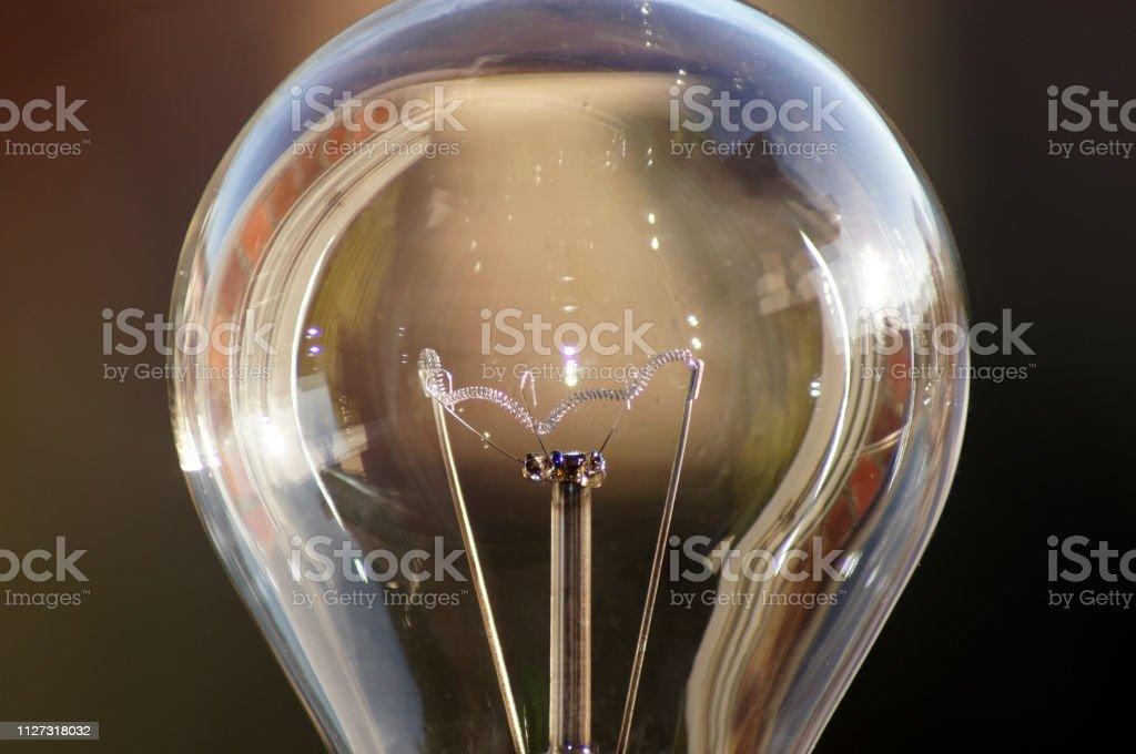 Close-up of a light bulb green current