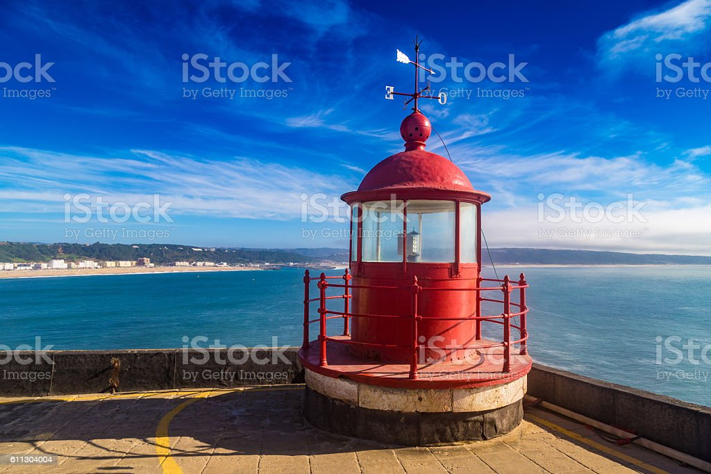 Closeup of a lighthouse lamp room on blue sky background stock photo