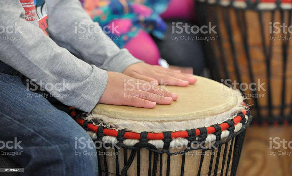 Close-up Of A Little Child Playing Drums royalty-free stock photo