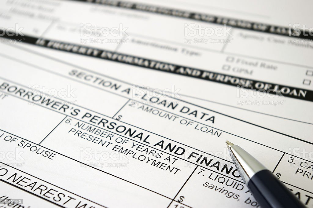 Closeup of a loan request form and a pen stock photo