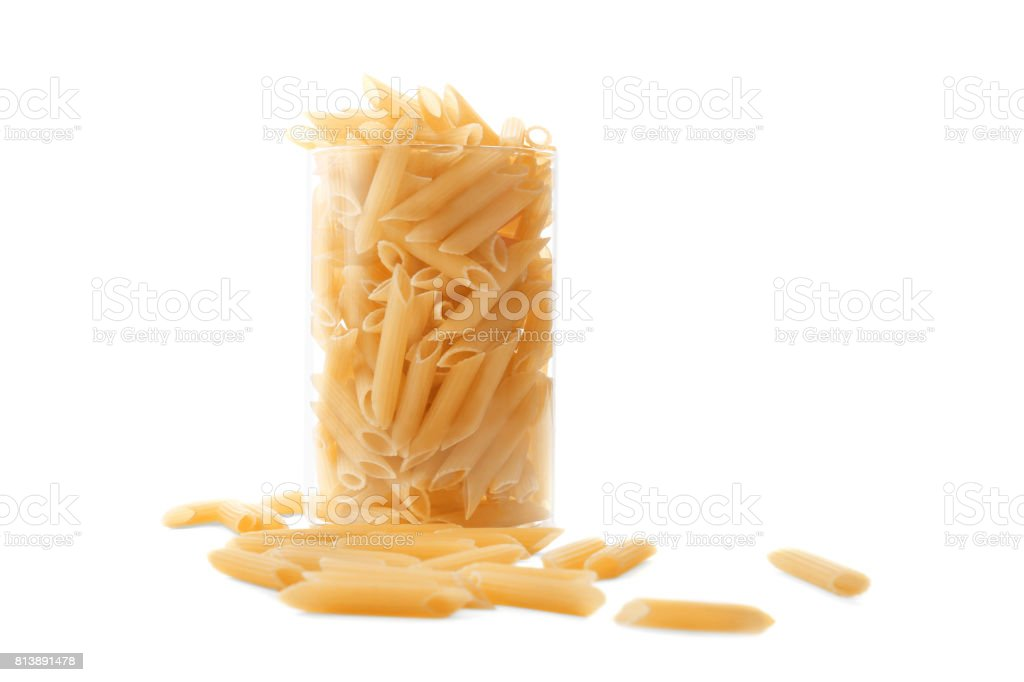 Close-up of a macaroni pasta  in a transparent glass, isolated on a white background. stock photo