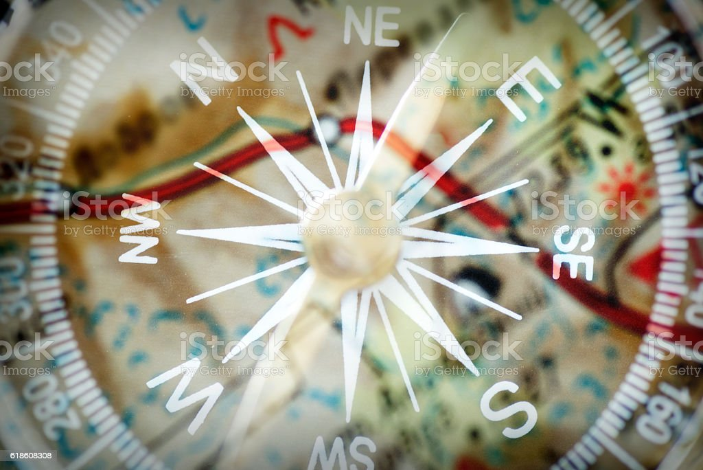 Close-up of a magnetic compass and a map stock photo