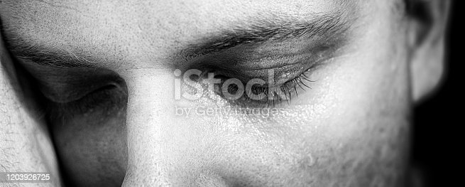 1091817198 istock photo Close-up of a male face with closed eyes on the subject of vulnerability, intimacy and depression 1203926725