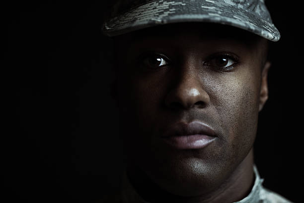 closeup of a male soldier - soldier stock photos and pictures