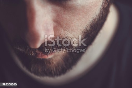 Man with beard and mustache looking down