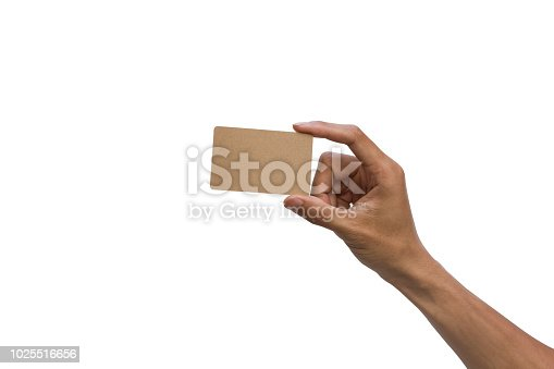 istock Close-up of a man hand holding brown empty card against white background include clipping path. 1025516656