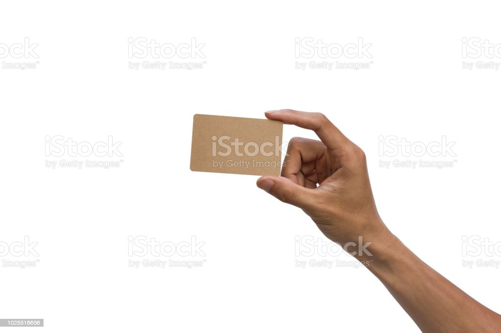 Close-up of a man hand holding brown empty card against white background include clipping path. stock photo