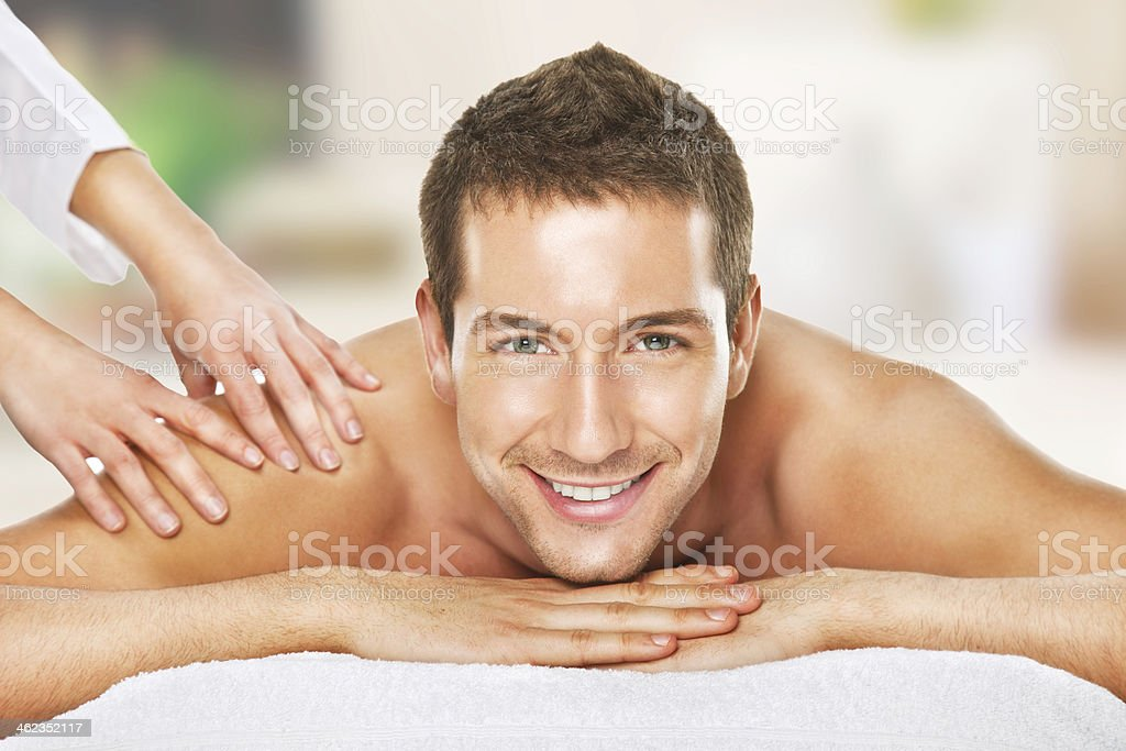 Closeup of a man having back massage stock photo