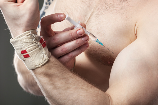 Closeup Of A Man Injecting Himself With Steroids Stock Photo - Download Image Now
