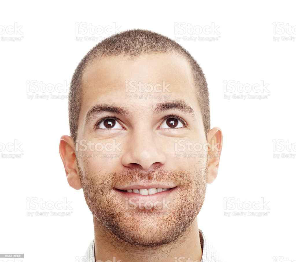 Closeup of a man looking upwards smiling on white royalty-free stock photo
